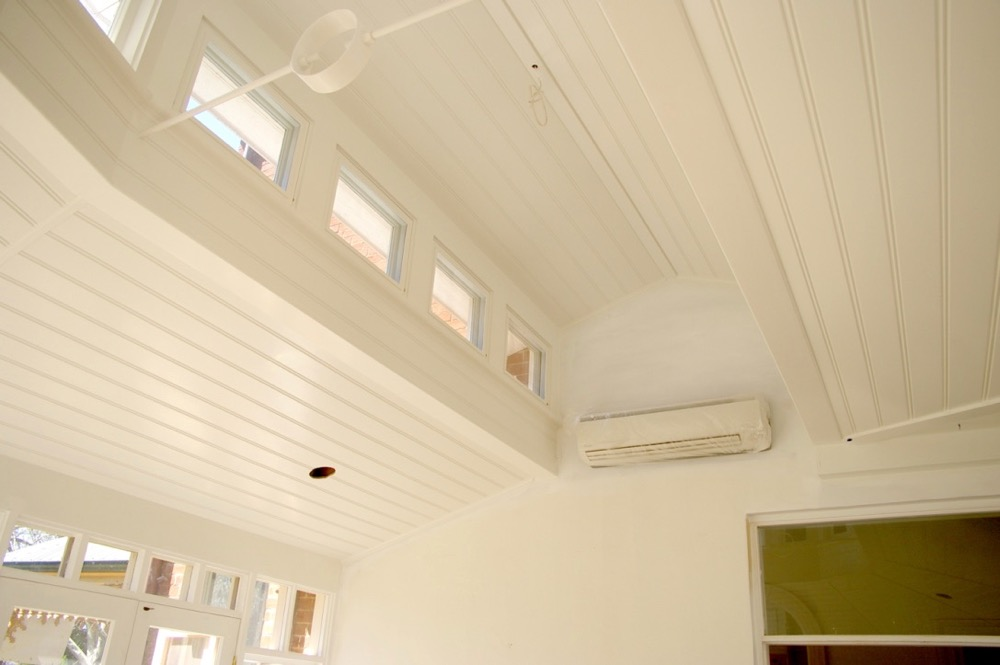 ceiling painting with white trim and air conditioner window edging