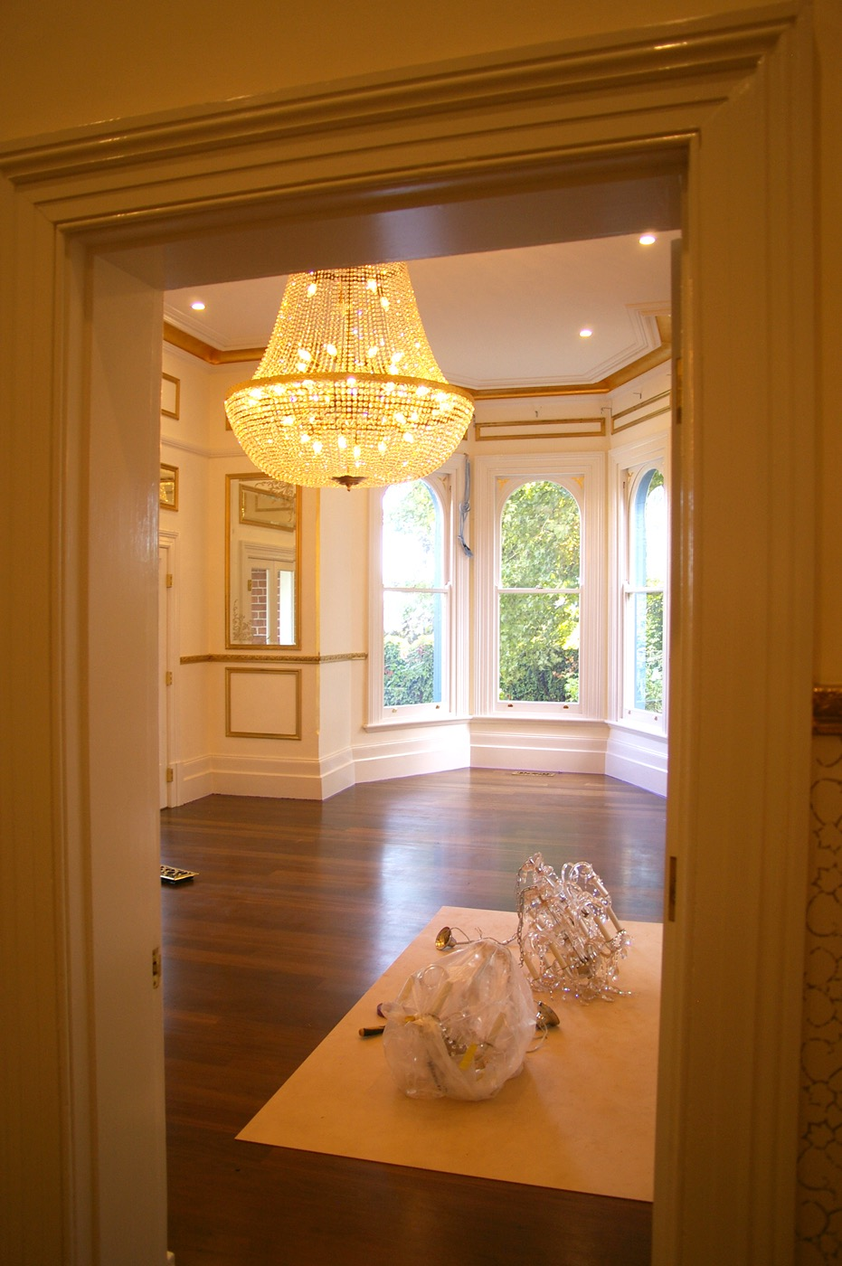 chandelier and interior house painting gold trim white millthorpe