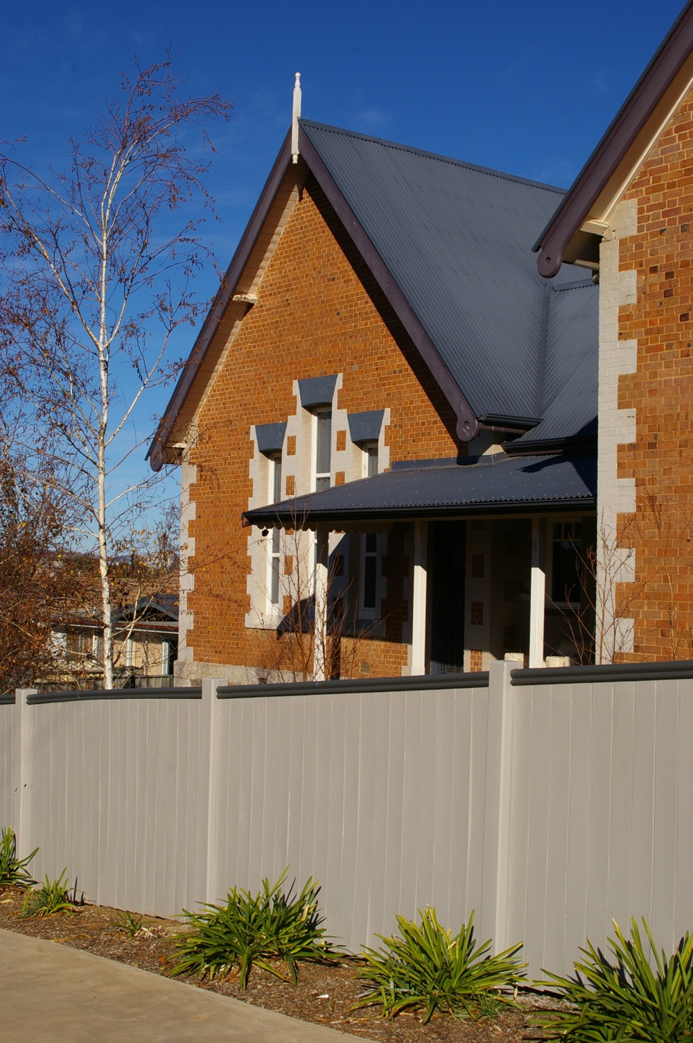 brick house exterior painting fence and roof trim